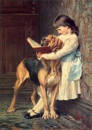 Child Reading With a Dog